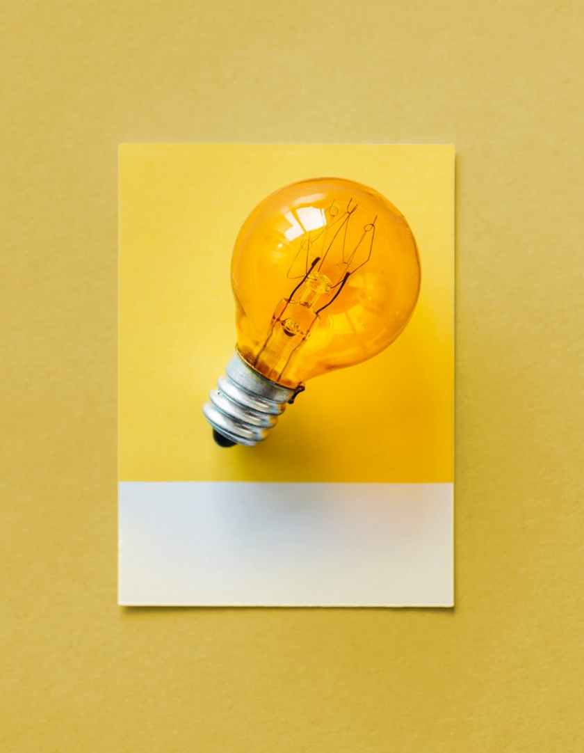 brown light bulb photo on yellow surface